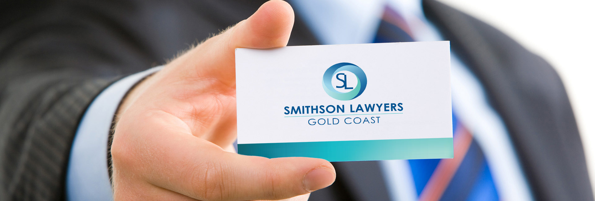 Person holding a business card